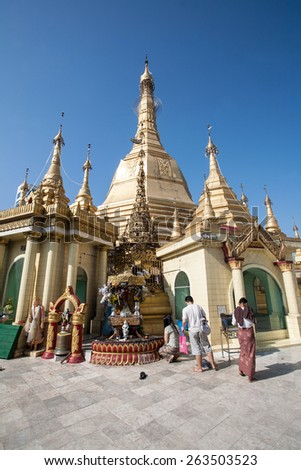 YANGON, MYANMAR - FEBRUARY 28: Unidentified people visit for pray the Sule Pagoda, It was built before the Shwedagon Pagoda during the time of the Buddha on February 28, 2015 in Myanmar. - stock photo