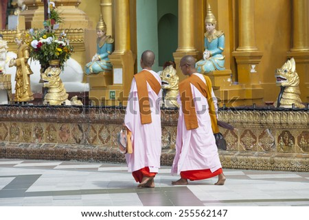 YANGON, MYANMAR - JAN 14, 2015: Shwedagon Pagoda in Rangoon. The famous chedi which is decorated with tons of jewelry. It also one of 5 greatest holy places in Myanmar. - stock photo