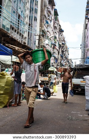 YANGON, MYANMAR - JUNE 12 2015: City center on one of the hottest recorded days before monsoon season in Yangon, Myanmar. - stock photo