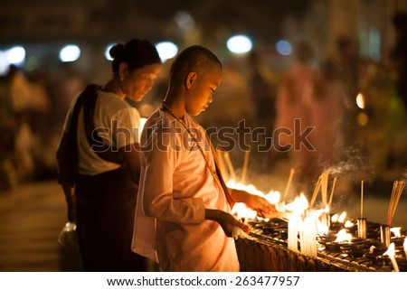 YANGON, MYANMAR - MARCH 28: Unidentified Buddhism's Nun pilgrimage at Shwedagon Pagoda, It's the third most important Buddhist pilgrimage site in Myanmar on February 28, 2015. - stock photo