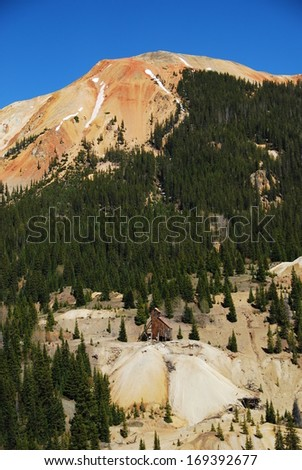 Yankee girl mine with Red Mountain #2 in the background, between Ouray and Silverton, CO, USA. - stock photo