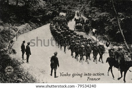 Yanks Going into Action France - Early 1900 postcard depicting Yankee soldiers going into action in France during WWI. - stock photo