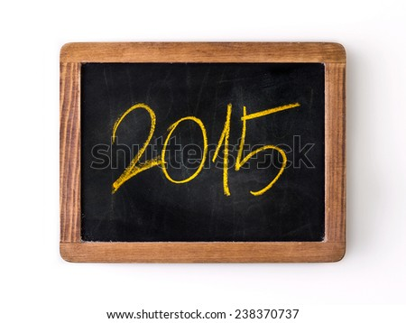 Yar 2015 written with a yellow chalk on a blackboard. - stock photo