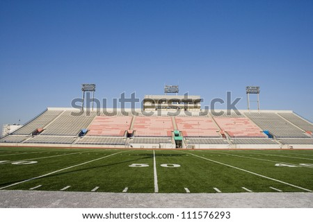 Yard lines on American football field in stadium - stock photo