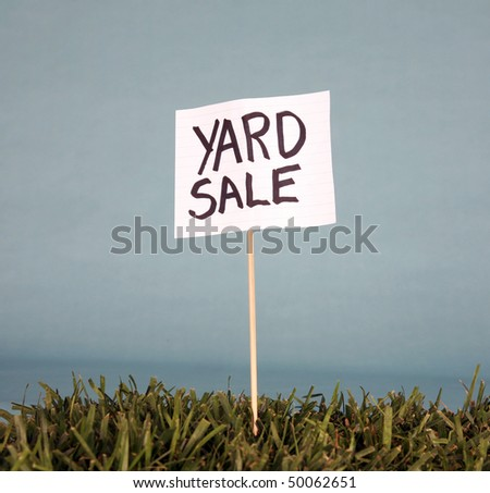 yard sale sign in grass - stock photo