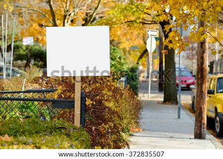 Yard sign in the fall - stock photo