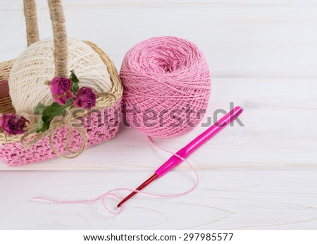 Yarn for crochet and  basket for handmade on white wooden boards in shabby chic style - stock photo