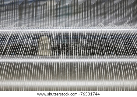 yarn warping machine in a textile weaving factory - stock photo