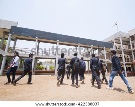 YAVATMAL, MAHARASHTRA,INDIA - APRIL 20, 2012 : Happy Students of engineering college running and  jumping together in front of their college, April 20, 2012 Yavatmal,Maharashtra,India. - stock photo