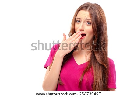 Yawning tired young woman. Beautiful caucasian model isolated on white background. - stock photo