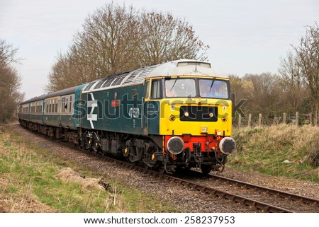 YAXHAM, UK - MARCH 20: A vintage ex British Rail class 47 diesel loco gives short trips to paying customers along the MNR railway during their spring diesel gala on March 20, 2011 in Yaxham - stock photo