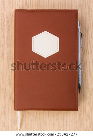 Year business project planner book with pen on wood table - stock photo