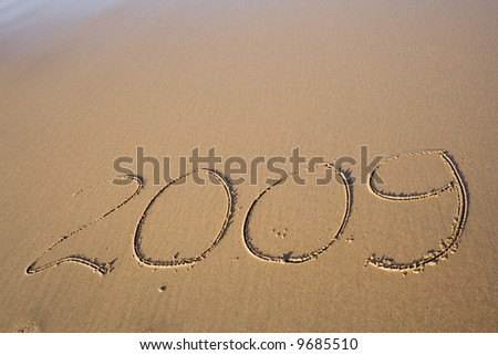 Year 2009 in the sand - stock photo