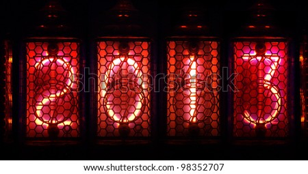 Year 2013 shown by numerical vacuum tubes, also known as Nixie tubes. Pink glowing numbers on black background. - stock photo