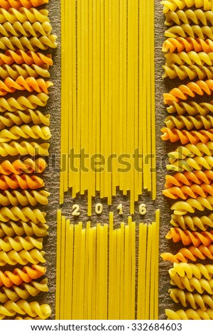 Year 2016 sign arranged with pasta on fabric texture - stock photo