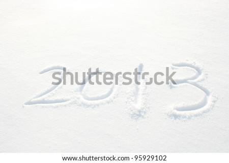 Year 2013 written in Snow in High Key - stock photo