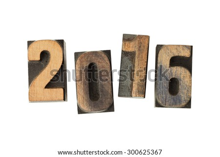 Year 2016 written with vintage letterpress printing blocks isolated on white background - stock photo