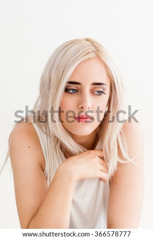 Yearning lonely woman looking down in disappointment. The concept of divorce, misunderstanding, loneliness. photo on the white background - stock photo