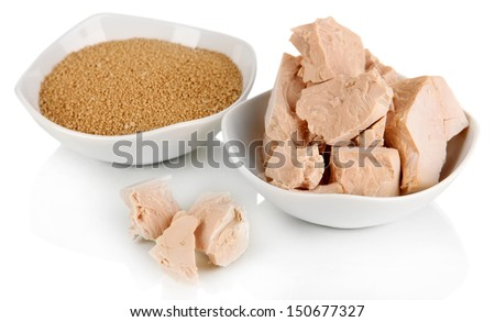 Yeast cubes in bowls isolated on white - stock photo