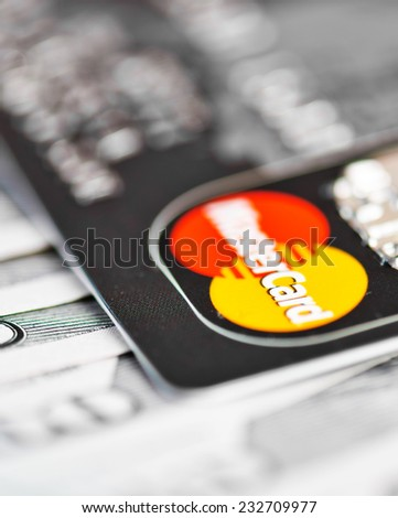 YEKATAERINBURG, RUSSIA - APR 25, 2014: Mastercard Debit Card Over Dollar bills  - stock photo