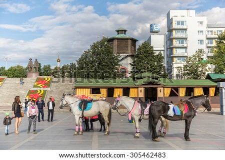 YEKATERINBURG, RUSSIA - AUG 07: Horses in the city center on August 07, 2015 in Yekaterinburg, Russia. - stock photo