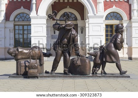YEKATERINBURG, RUSSIA - AUGUST 01, 2015: Sculpture passengers near the railway station in the Russian city of Yekaterinburg - stock photo