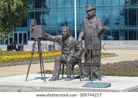 YEKATERINBURG, RUSSIA - JULY 20, 2015: Monument to Lumiere brothers. The monument by sculptor Diana Kosygina was unveiled on August 27, 2012 to commemorate the 150th anniversary of Auguste Lumiere. - stock photo