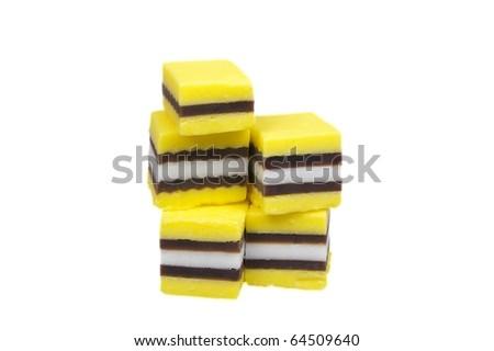 yellow and black plus white licorice over white - stock photo