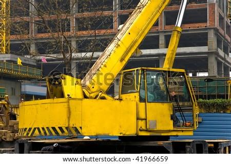 Yellow and black telescopic crane control cabin and gib arm closeup. - stock photo