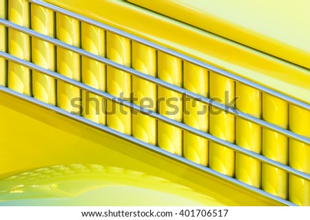 yellow and chrome art-deco style vehicle panel abstract - stock photo