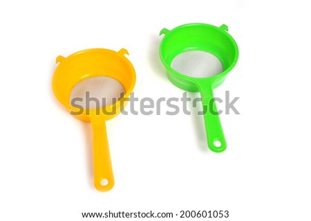 Yellow and Green handle colander isolated on white background - stock photo