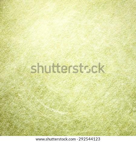 Yellow and green light shabby metallic background - stock photo