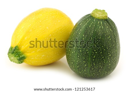 yellow and green zucchini (Cucurbita pepo) on a white background - stock photo