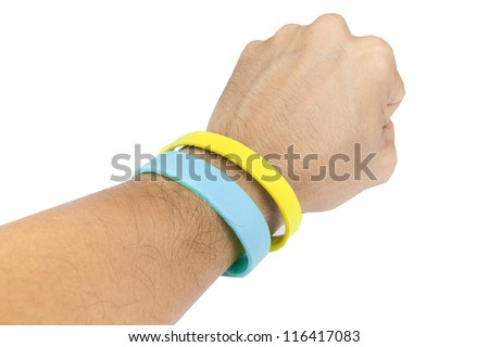 Yellow and light blue rubber bracelet. Yellow is colour of King, light blue is Queen of Thailand. - stock photo