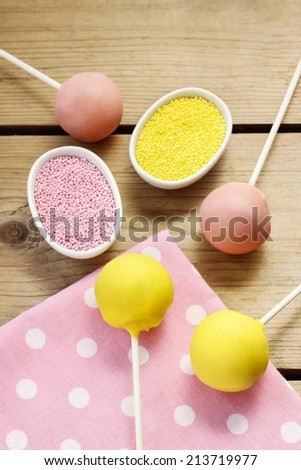 Yellow and pink cake pops - stock photo