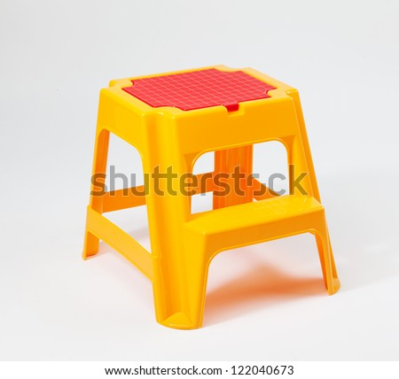 Yellow and red children plastic stairs - stock photo