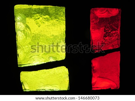 Yellow and red chipped slab glass in stained glass window in a church - stock photo