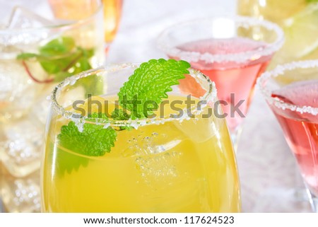 Yellow and red margaritas with salt - stock photo