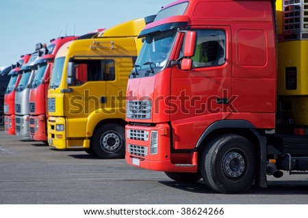 yellow and red semi trucks - stock photo