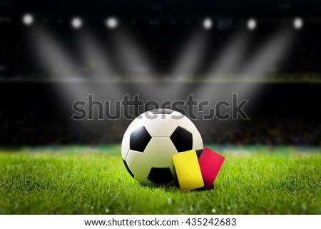 Yellow and Red soccer card,soccer field and stadium with fans the night light before the match,soccer stadium,soccer match, soccer on grass,soccer football, soccer team, soccer sport, soccer at night. - stock photo