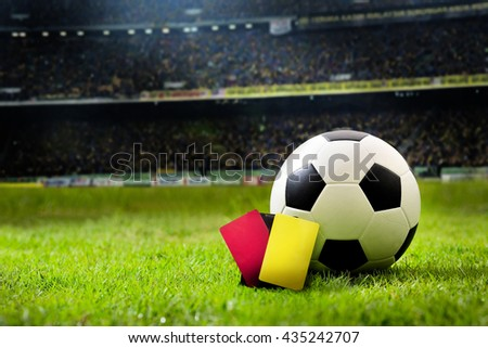 Yellow and Red soccer card. soccer field and stadium with fans the night light before the match, soccer stadium,soccer match,soccer on grass,soccer football, soccer team, soccer sport,soccer at night. - stock photo