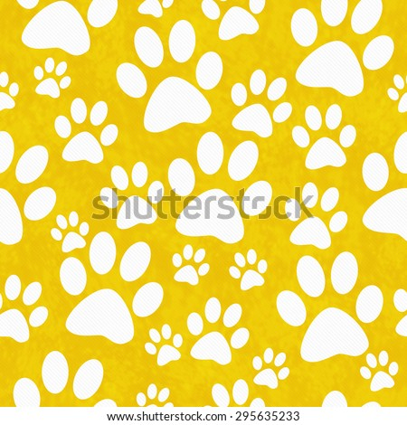 Yellow and White Dog Paw Prints Tile Pattern Repeat Background that is seamless and repeats - stock photo