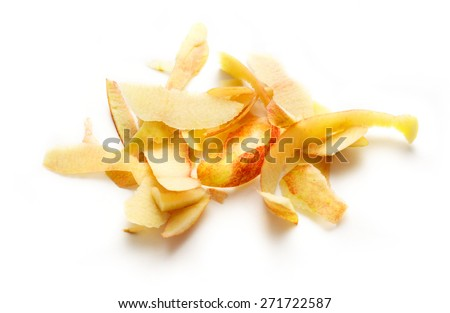 Yellow apple peelings on the white background - stock photo