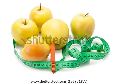 yellow apples and measuring tape clothespin isolated on white background - stock photo