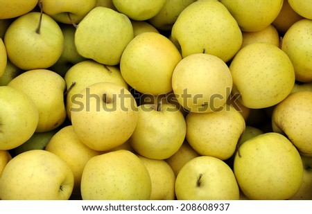 yellow apples at the greengrocer on a farmers market - stock photo