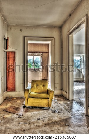 Yellow armchair in an abandoned house, HDR - stock photo