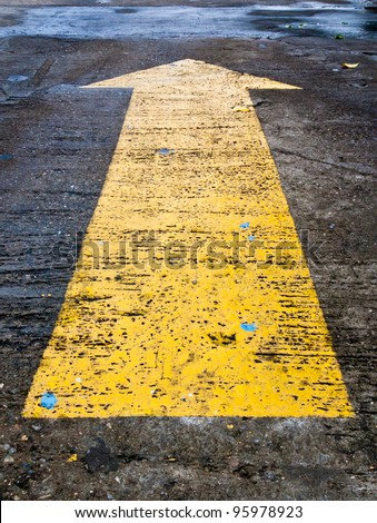 Yellow arrow to indicate the travel of the arrow - stock photo