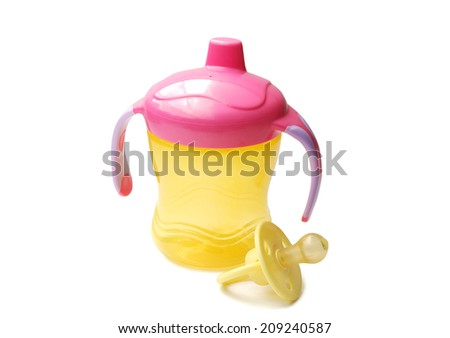 Yellow baby bottle with pacifier a white background - stock photo