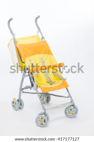 Yellow baby carriage on a white background - stock photo