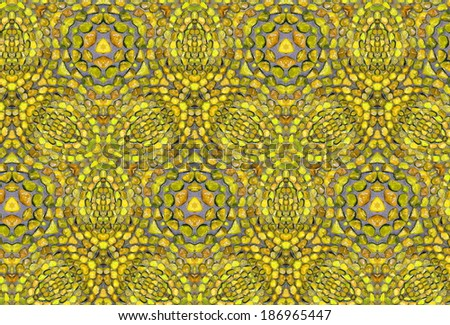 Yellow background with a traditional arabic pattern made from little stones  - stock photo